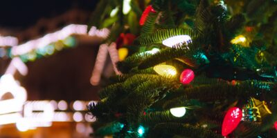 Christmas Tree in a market with lights on